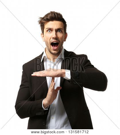 Young man gesturing time out sign on the white background