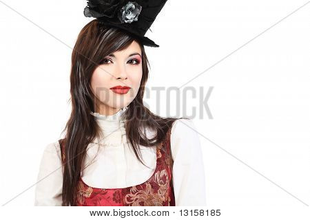Portrait of the elegant young woman in 19th century costume holding walkingstick in her hands. Shot in a studio.