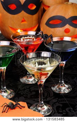 Glasses with different drinks on the table in honor of Halloween