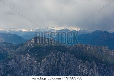 Storm clouds over the Dolomite mountains view from mount Monte Baldo Italy
