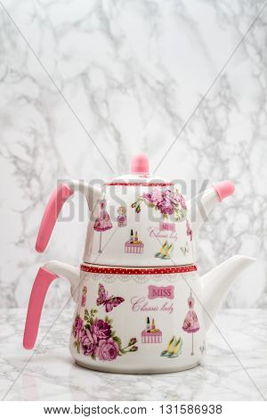 Teapot Made Of Porcelain With A Pattern Of Roses