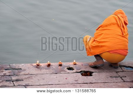 Woman preparing a pooja on the Ganges River in Varanasi India