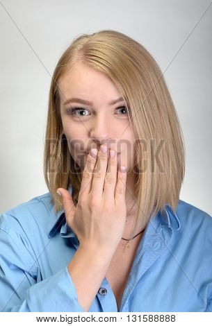 Beautiful Young Woman Covering The Mouth With Her Hand