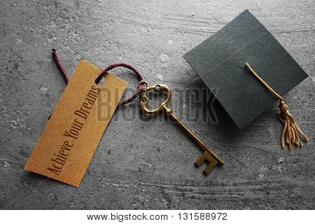 Achieve Your Dreams key tag with graduation cap