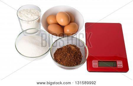 Flour eggs sugar cocoa on a white background