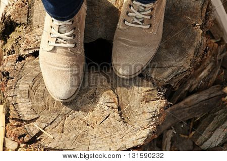 Shoes on a wooden stump.