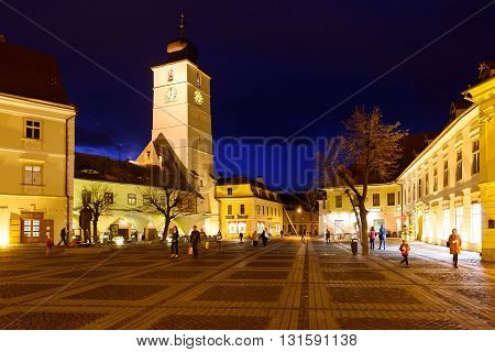 SIBIU, ROMANIA - MARCH 08, 2016: Photo of city council and main square in the night, at the woman's day celebration