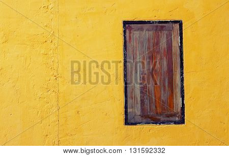 old dirty window on yellow wall background
