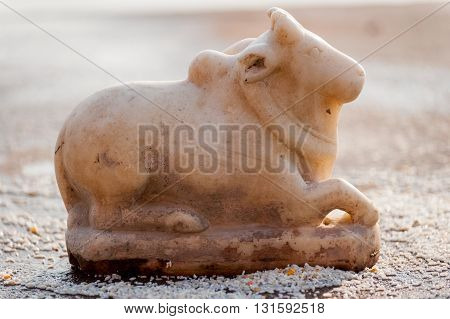 Small stone carved Nandi in Varanasi, India