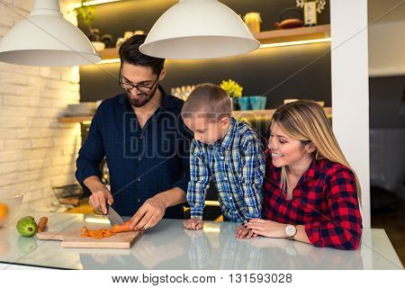 Happy family cooking together in the kitchen.