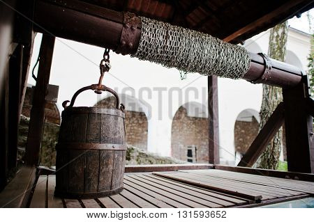 Old Wooden Water Well With Pulley And Bucket. Palanok Castle