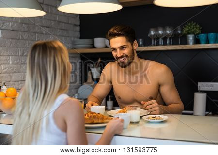 Couple in love enjoying a breakfast together.