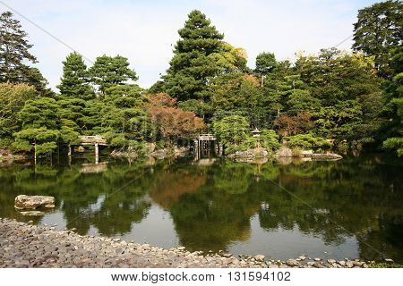 Japanese style garden with a pond and trees