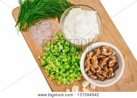 Products for traditional greek Tzatziki salad close up.