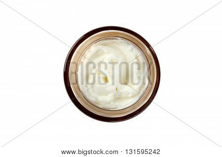tub with a face cream with a brown cover on a white background