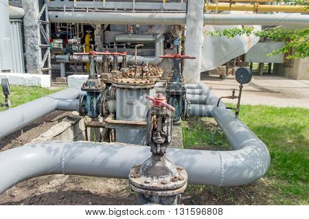 Faucet with steel pipes in natural gas processing plant in summer day