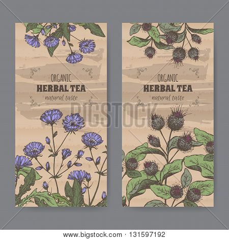 Set of two color vintage labels for burdock and chicory herbal tea. Placed on cardboard texture.