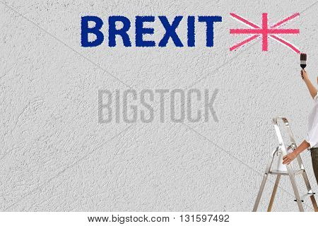 a woman paint brexit on a wall
