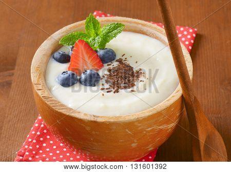 bowl of semolina pudding with fresh fruit - close up