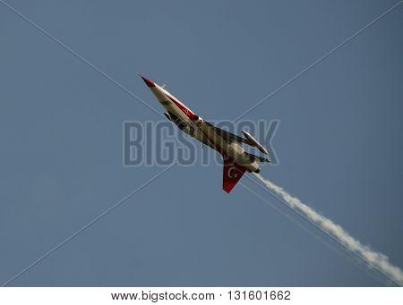 ANKARA - JUNE 24,2012 : Turkish Stars Aerobatic Team over the Mogan Lake during the air display. JUNE 24, 2012-ANKARA/TURKEY