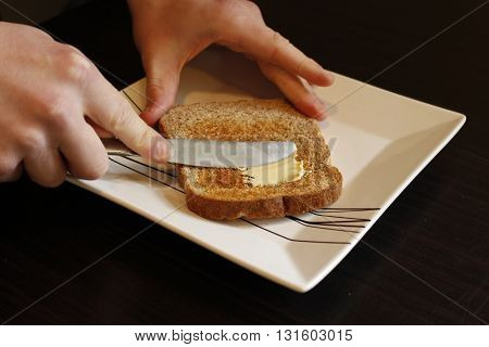 Hot Fresh Toast Being Buttered On A Plate