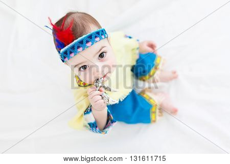 Portrait of the little boy dressed as a native american child in a studio