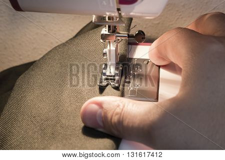 Baking process - the hands of the men behind sewing