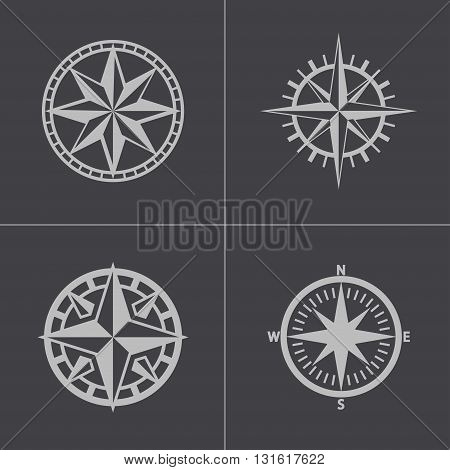 Vector black compass icons set on grey background