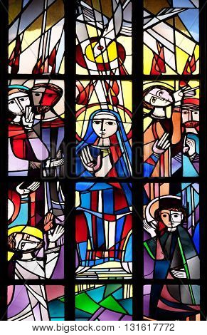 KLEINOSTHEIM, GERMANY - JUNE 08: Pentecost stained glass window in the Saint Lawrence church in Kleinostheim, Germany on June 08, 2015.