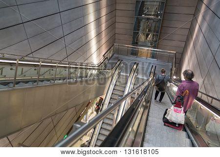 Copenhagen, Denmark - April 25, 2016: People using escalator in metro station