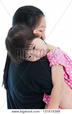 Lovely Asian Girl Relaxing On Mom's Shoulder, Happy Family Concept. Mothers Day Celebration.