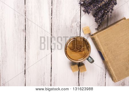 Cozy morning concept: cup of coffee, vintage book and dry lavender