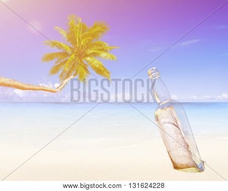Message in a Bottle on Beach Concept