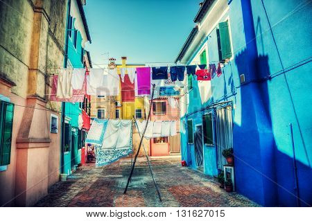 Linens drying outdoors on Venice Italy street. Vibrant hdr style colors.