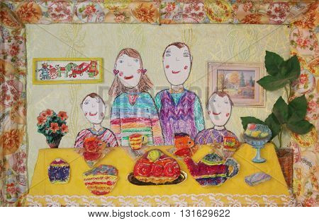 Happy family with two children drink tea. Batik