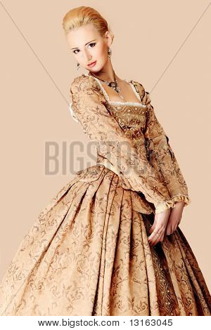Portrait of a beautiful woman in medieval era dress. Shot in a studio.