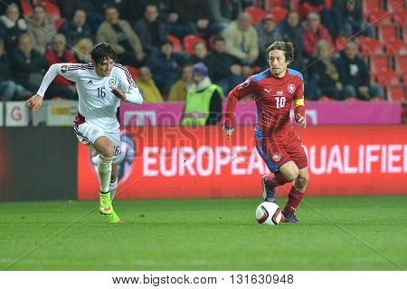Prague 28/03/2015 _ Igors Tarasovs and Tomas Rosicky. Match of EURO 2016 qualification group A Czech Republic - Latvia 1:1 (0:1). Goals 90' Pilař - 30' Višnakovs.
