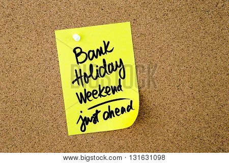 Bank Holiday Weekend Just Ahead Written On Yellow Paper Note