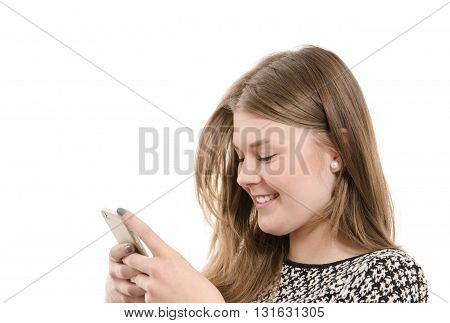 Happy female teenager writing on a mobile phone