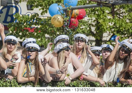 HELSINGBORG SWEDEN - JUN 05: Graduates from different schools take part in a celebration parade throught the town centre on June 05 2015 in Helsingborg Sweden.