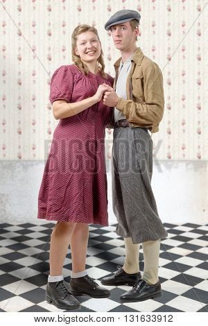 a young dancers couples in vintage clothing 40s