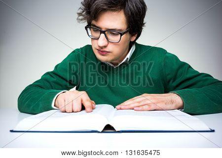 Man Reading Big Book