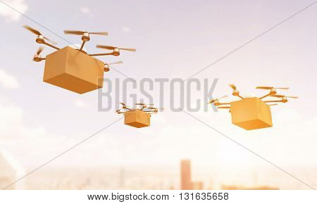 Quadrocopters With Cargo In Sunlight