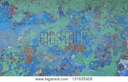 Peeling paint on wall grunge texture. Pattern of rustic blue and green grunge material closeup.