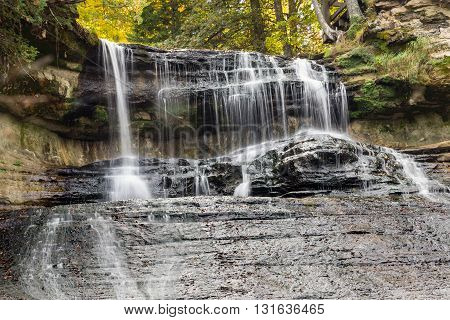Laughing Whitefish Falls near Chatham Michigan with a background of autumn colors.