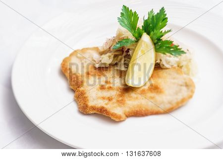Schnitzel with cabbage
