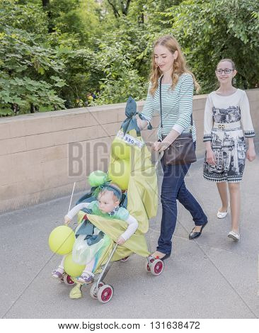 Rostov-on-Don Russia- May 22, 2016: Mother walks with her daughter and the baby in carnival costume