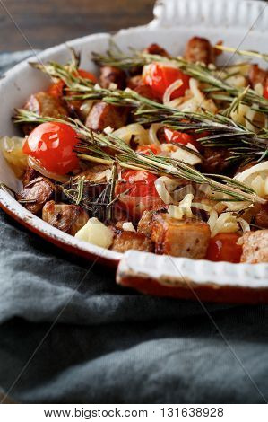 Closeup of Roasted Chicken Meat with tomatoes and spices on frying pan