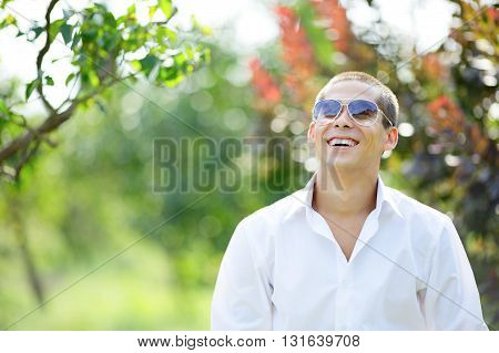 Laughing Young Man In Sunglasses On Outdoors