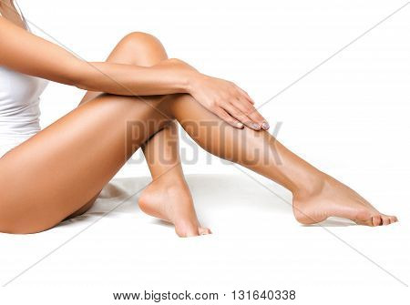 Sexy and Healthy female Legs. Spa. Long woman legs on bed isolated on white background. Skin care. Depilation. Epilation